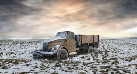 A picture of the abandoned Soviet truck in the midst of snowy plain