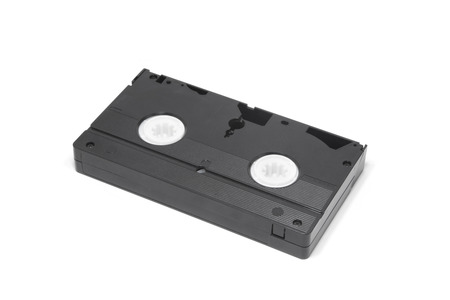superseded: Old video tape isolated on white background. Stock Photo