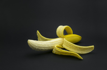 Fresh, yellow banana on black background.
