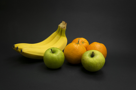 Healthy fruits on black background. Stock Photo