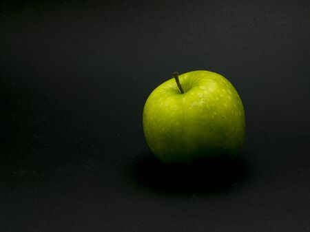 green apples: Green apples on black background. Stock Photo