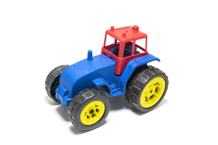 Colorful toy tractor isolated on white background.