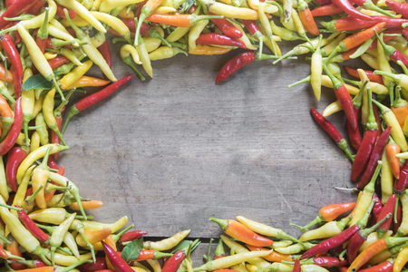 Chilli peppers on wooden background.