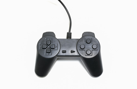 Black game controller isolated on white background.