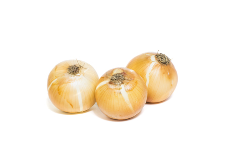 Brown onions isolated on white background.