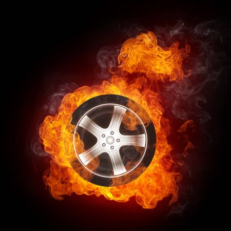 Car Wheel in Fire isolated on Black Background. Computer Design. photo