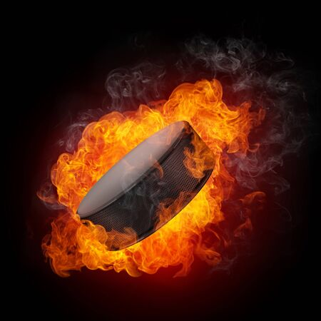 ice hockey puck: Hockey Puck in fire Isolated on Black Background Stock Photo