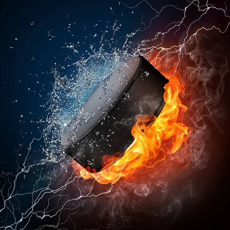 Hockey Puck in fire Isolated on Black Background Stock Photo