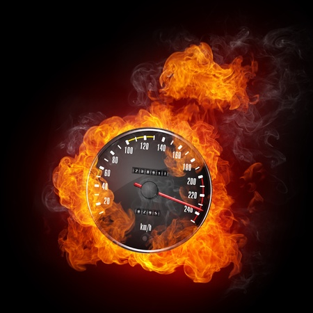 furious: Speedometer in Fire Isolated on Black Background Stock Photo