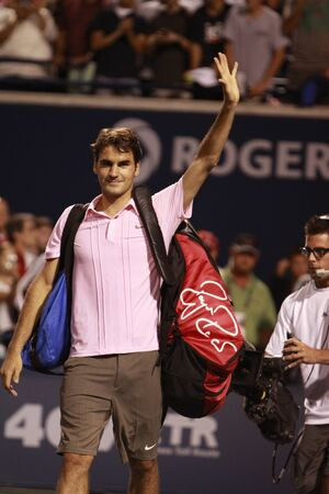 TORONTO: AUGUST 14. Roger Federer greets fans after he won a tournament with Novak Djokovic  in the Rogers Cup 2010 on August 14, 2010 in Toronto, Canada.