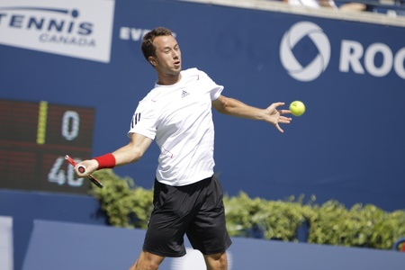 forehand: TORONTO: AUGUST 13. Philipp Kohlschreiber plays against Rafael Nadal   in the Rogers Cup 2010 on August 13, 2010 in Toronto, Canada.
