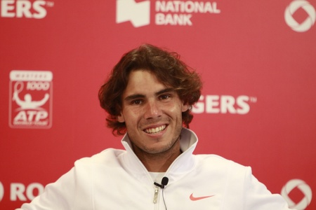 nadal: TORONTO: AUGUST 13. Rafael Nadal gives an interview in press conference after he won a tournament with Philipp Kohlschreiber in the Rogers Cup 2010 on August 13, 2010 in Toronto, Canada.
