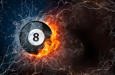 lightening: Billiard ball on fire and water with lightening around on black background. Horizontal layout with text space. Stock Photo