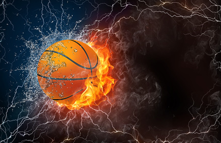 Basketball ball on fire and water with lightening around on black background. Horizontal layout with text space. Archivio Fotografico