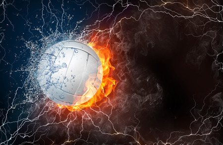 fastball: Volleyball ball on fire and water with lightening around on black background. Horizontal layout with text space. Stock Photo