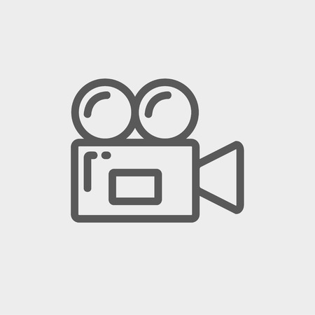 video camera icon: Video camera icon thin line for web and mobile, modern minimalistic flat design. Vector dark grey icon on light grey background. Illustration