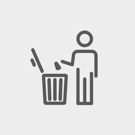garbage man: Man throwing garbage in a bin icon thin line for web and mobile, modern minimalistic flat design. Vector dark grey icon on light grey background.
