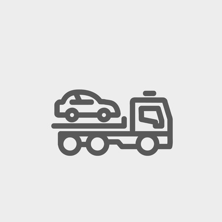 Car towing truck icon thin line for web and mobile, modern minimalistic flat design. Vector dark grey icon on light grey background.