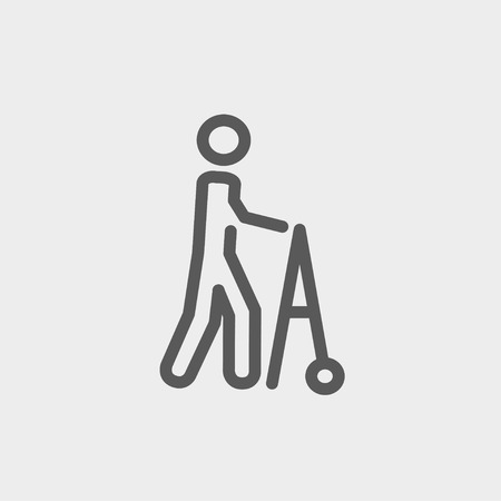Disabled person with walker icon thin line for web and mobile, modern minimalistic flat design. Vector dark grey icon on light grey background.