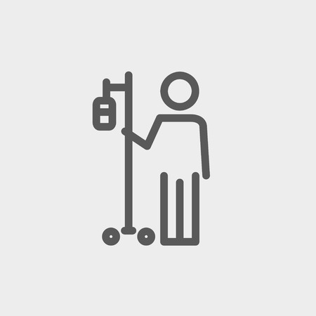 sick person: Patient standing with intravenous saline solution icon thin line for web and mobile, modern minimalistic flat design. Vector dark grey icon on light grey background. Illustration