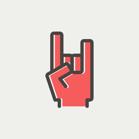 rock and roll: Rock hand icon thin line for web and mobile, modern minimalistic flat design. Vector icon with dark grey outline and offset colour on light grey background.