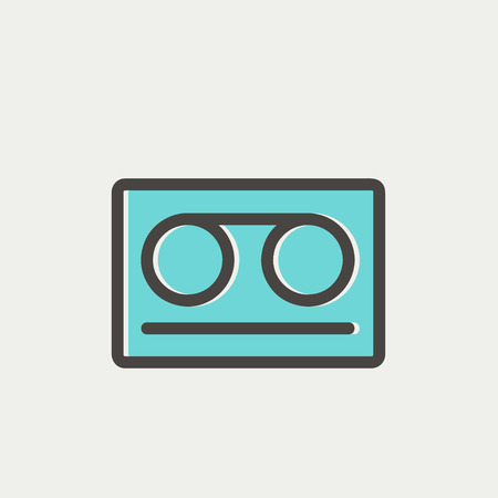 walkman: Cassette tape icon thin line for web and mobile, modern minimalistic flat design. Vector icon with dark grey outline and offset colour on light grey background.