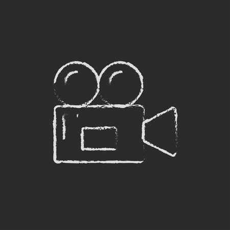 Video camera hand drawn in chalk on a blackboard vector white icon on a black background
