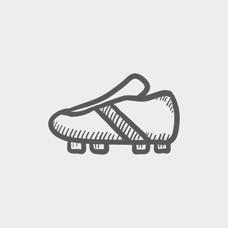 soccer shoes: Soccer shoes sketch icon for web and mobile. Hand drawn vector dark grey icon on light grey background.