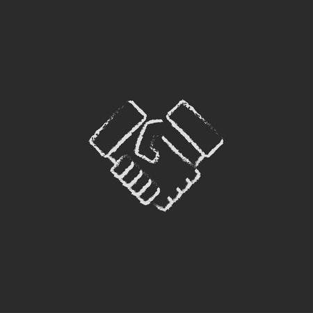 Poignée de main dessiné à la main à la craie sur un tableau noir vecteur icône blanche isolé sur un fond noir. Banque d'images - 45317900