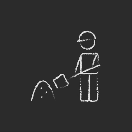 hand shovels: Man with shovel and sand hand drawn in chalk on a blackboard vector white icon isolated on a black background.