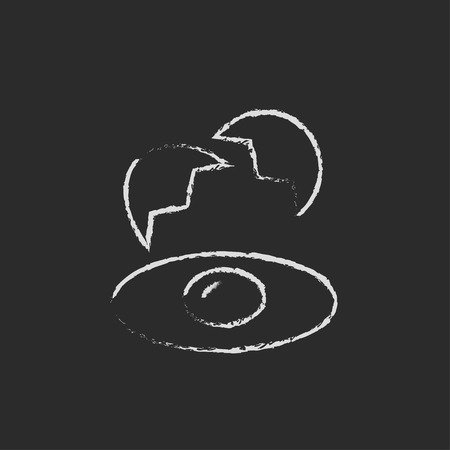 Broken egg and shells hand drawn in chalk on a blackboard vector white icon isolated on a black background. Ilustrace