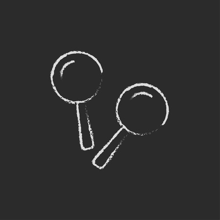 beanbag: Maracas hand drawn in chalk on a blackboard vector white icon isolated on a black background.