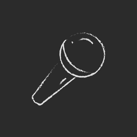 Microphone hand drawn in chalk on a blackboard vector white icon isolated on a black background.