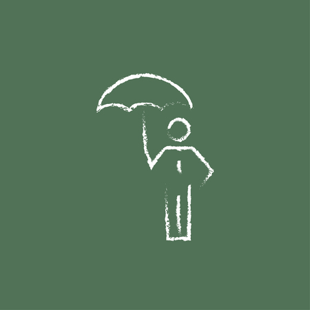 guy standing: Businessman with umbrella hand drawn in chalk on a blackboard vector white icon isolated on a green background.
