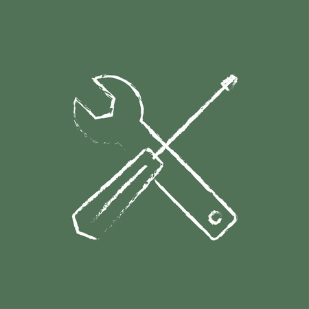 Screwdriver and wrench tools hand drawn in chalk on a blackboard vector white icon isolated on a green background. Illustration