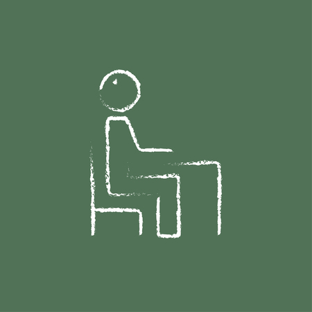 schoolroom: Student sitting on a chair in front of the desk hand drawn in chalk on a blackboard vector white icon isolated on a green background. Illustration