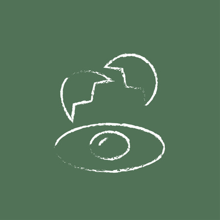 broken egg: Broken egg and shells hand drawn in chalk on a blackboard vector white icon isolated on a green background. Illustration