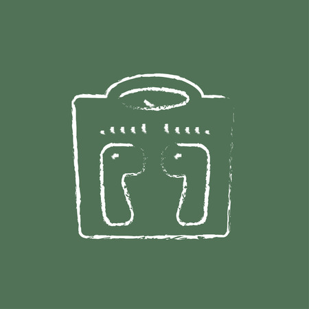 weighing scale: Weighing scale hand drawn in chalk on a blackboard vector white icon isolated on a green background.