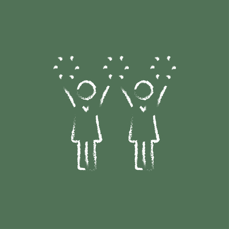 cheerleading: Cheerleaders hand drawn in chalk on a blackboard vector white icon isolated on a green background.