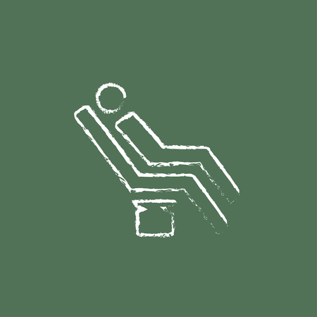 sillon dental: Man sitting on a dental chair hand drawn in chalk on a blackboard vector white icon isolated on a green background. Vectores