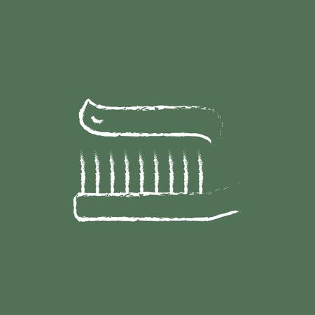 緑の背景に分離された黒板白ベクトル アイコンにチョークで描かれた歯磨き粉手で歯ブラシ。
