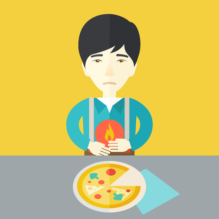 A sick asian man with heartburn due to pizza holding hands on his stomach vector flat design illustration. Square layout. Illustration