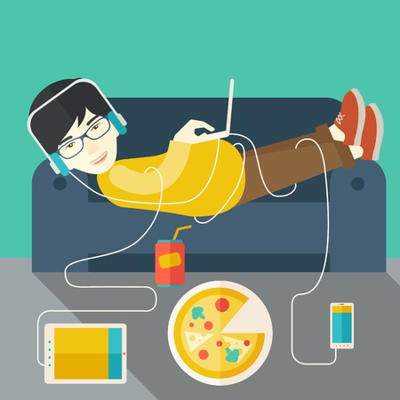person computer: An asian man in glasses and headphones lying on a sofa with electronic devices and fast food vector flat design illustration. Square layout.