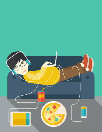 An asian man in glasses and headphones lying on a sofa with electronic devices and fast food vector flat design illustration. Vertical layout with a text space. Illustration