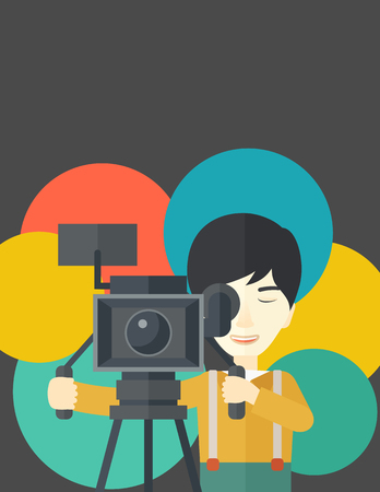 cinematographer: An asian cameraman looking through movie camera on a tripod vector flat design illustration. Vertical layout with a text space.