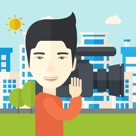 cinematographer: An asian cameraman with video camera taking a video with buildings around vector flat design illustration. Square layout.