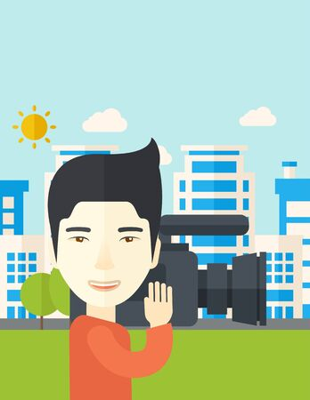 An asian cameraman with video camera taking a video with buildings around vector flat design illustration. Vertical layout with a text space. Illustration