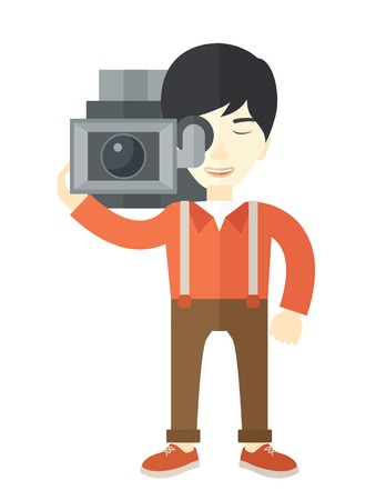 cameraman: An asian cameraman with video camera taking a video vector flat design illustration isolated on white background. Vertical layout.