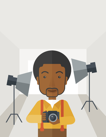 the photographer: A smiling african-american photographer holding a camera and standing inside the studio with the light vector flat design illustration. Vertical layout with a text space.