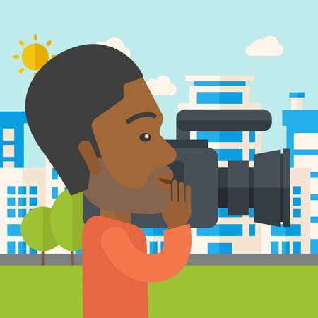 An african-american hipster cameraman with video camera taking a video with buildings around vector flat design illustration. Square layout.